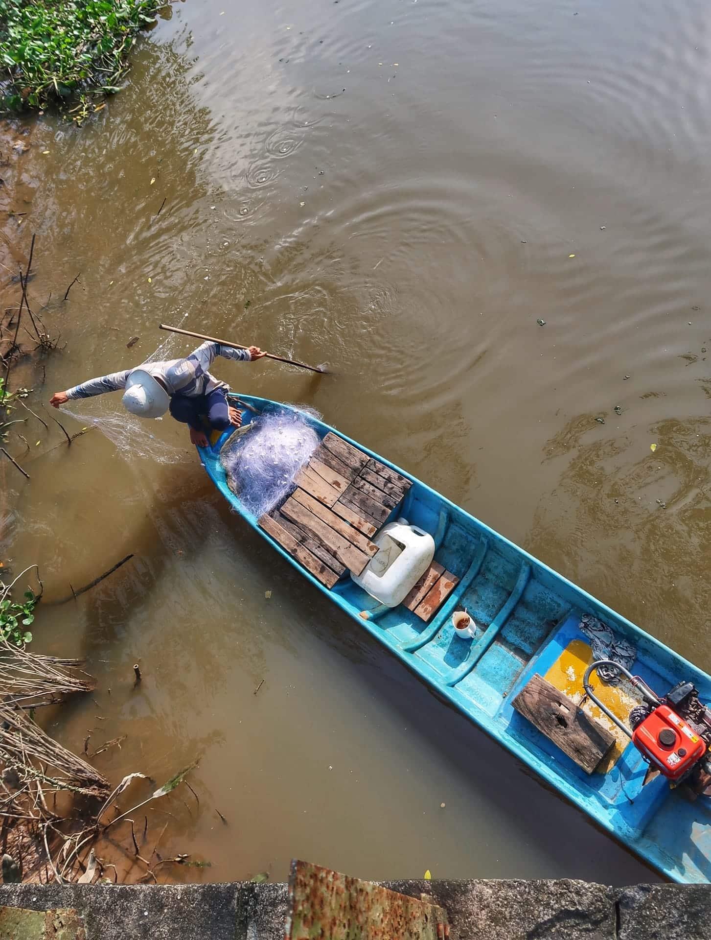 Fiskermand på Mekong River